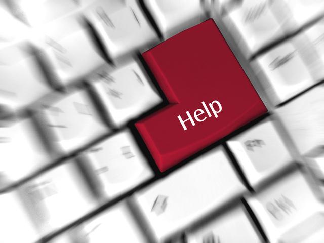 rozmazaná klávesnice, uprostřed červený výrazný help místo entru